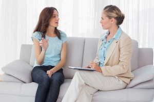 Woman talking to her psychotherapist.